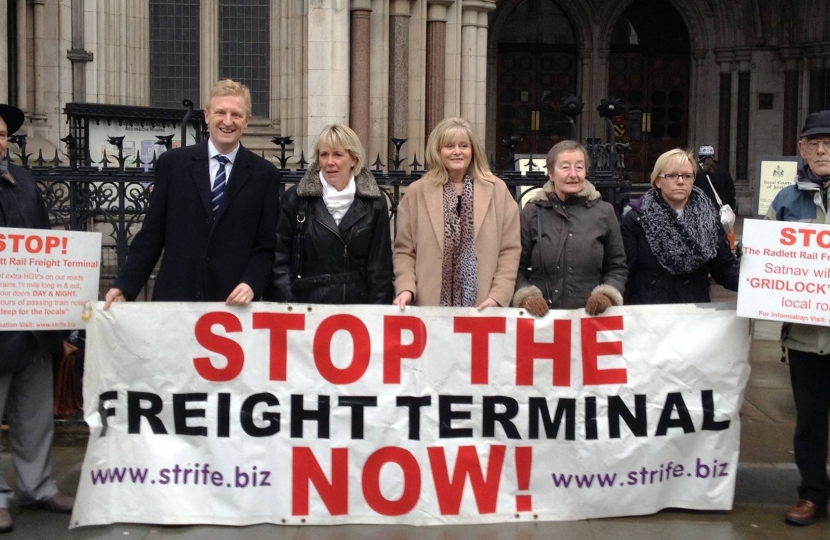 Oliver Dowden MP with anti-rail freight campaigners outside the High Court